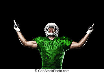 Football Player with a Green uniform celebrating on a black...