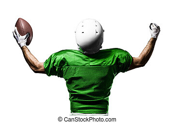 Football Player with a Green uniform celebrating on a white...