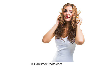 beautiful young girl with long curly hair listening to sea music in cockleshell on isolated white background
