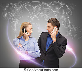 man and woman calling with smartphones - business,...