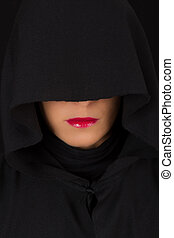 Woman in black cape with sad face and red lips portrait