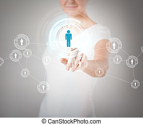 businesswoman pressing button with contact - business,...