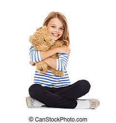 cute little girl hugging teddy bear - childhood, toys and...