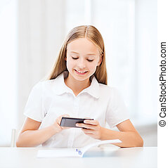 girl with smartphone at school - education, school,...