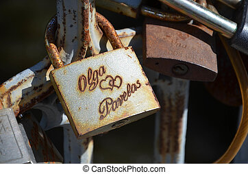 Old rusted padlock as a proof of love