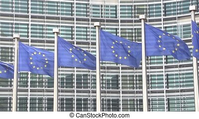 European Flags waving slow motion at berlamont building in...