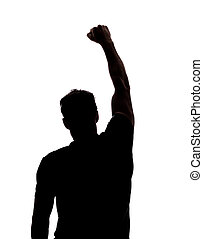 Fist in the air in silhouette isolated over white background