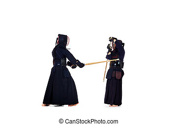 demonstration - Two kendo fighters are fighting with each...