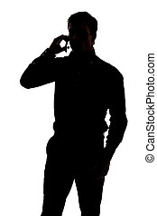 Man talking on cell phone in silhouette isolated over white...