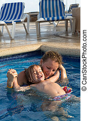 Mother and Daughter Playful in the Pool