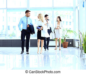 businesspeople walking in the corridor