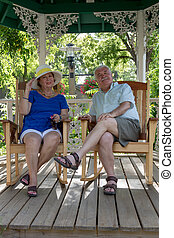 Senior Couple Resting in the Gazebo - Senior couple resting...