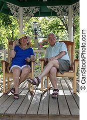 Senior Couple Resting in the Gazebo - Senior couple resting...