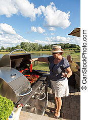 Senior Couple Barbecuing - An old couple enjoying grilling...