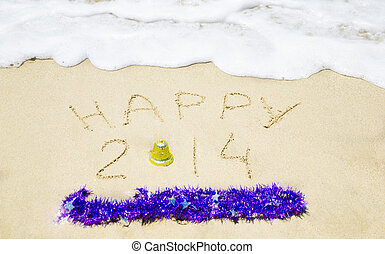 """Sign """"Happy 2014"""" on the sand - holiday concept"""