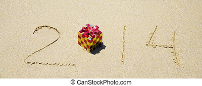 Number 2014 on sandy beach - holiday concept