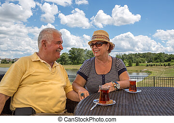 Senior Couple Having Hot Turkish Tea - Senior Couple having...