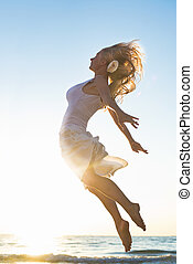 Happy Woman Jumping at the sea - Happy Woman Jumping in the...