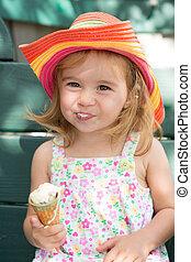 Cute little girl eating her ice cream
