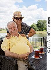 Loving senior couple having drinks