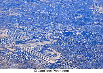 Aerial view of urban sprawl - Aerial view of airport and...