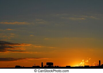 Orange sunset and roof silhouette - Industrial roof...