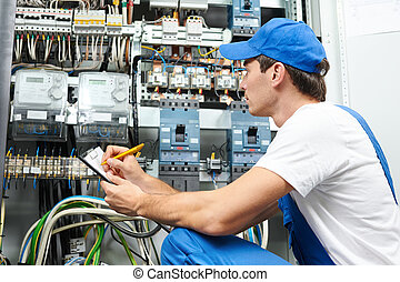 electrician worker inspecting - Young adult electrician...