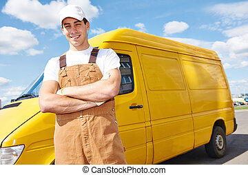 Delivery man with distribution van - Smiling young male...
