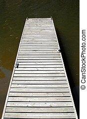 Empty wooden dock on water - Empty wooden dock with metal...
