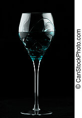Wine glass with turquoise potion