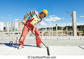 builder worker installing concrete slab - builder worker...