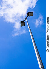 Floodlight with blue sky as the background
