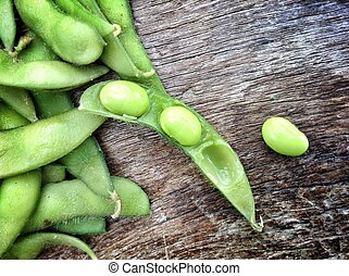 Fresh soybeans - Green fresh soybeans on wood background