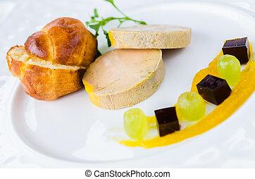 Foie gras with port wine jelly , mango confit and brioche