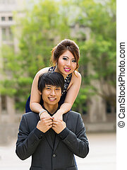 Young Couple Holding Each Other Outdoors