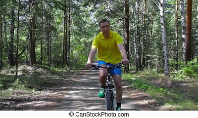 Happy cyclist - Active guy enjoying his bicycle ride in the...