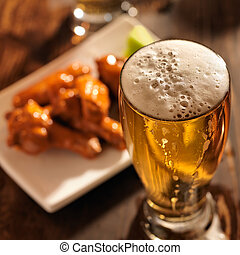 beer and chicken wings close up