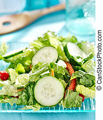 salad with cucumbers close up on glass plate