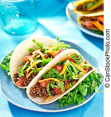 Mexican food - Soft shell tacos with beef, cheese, lettuce...