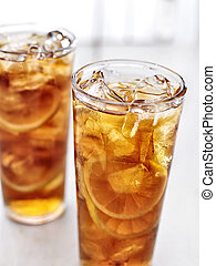 cold iced tea with lemons.
