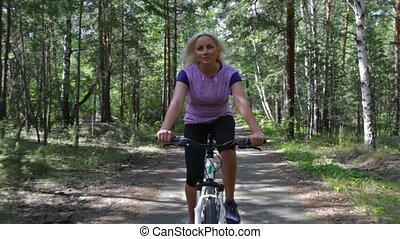 Active weekend - Active woman spending her weekend outdoors...