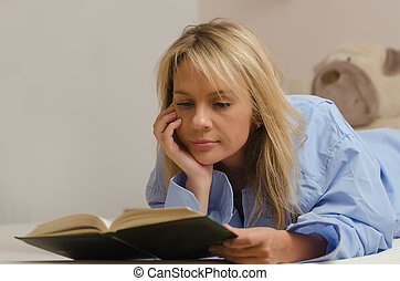 young beautiful woman reading book - More photos of this...