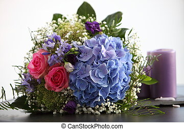 Unusual bridal bouquet with pink roses and blue hydrangeas...