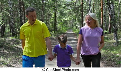 Family walk - Carefree family of four walking in the summer...