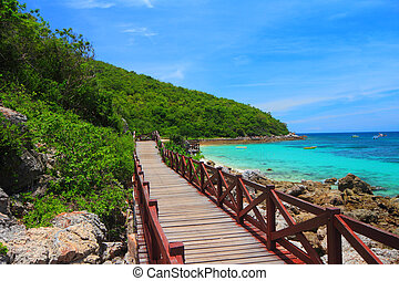 jetty to a tropical beach on island, at koh lan island...