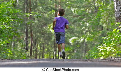 Runaway - Little boy running away in the woods