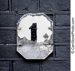 Number 1 - heavily weathered house number one Paint on a...