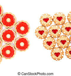 Heart and round shaped strawberry biscuits White background...