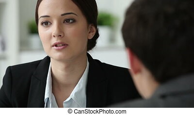 HR professional - Hr department worker interviewing a male...
