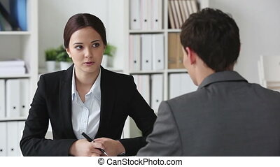 Business meeting - Consultant meeting her client to clarify...